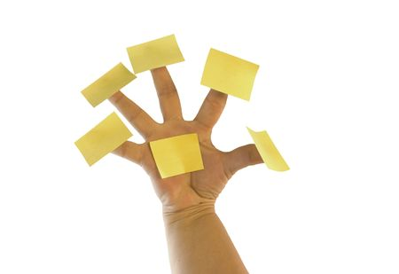 post: Yellow post notes on fingers of a female hand