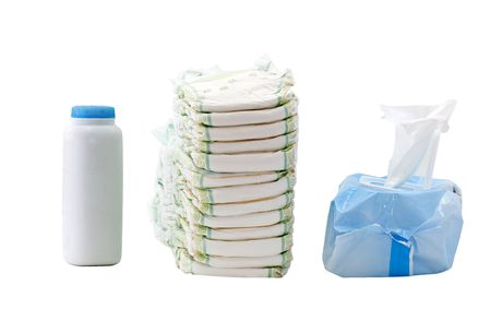 container of baby powder, stack of diapers, package of wipes