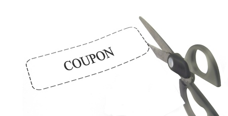 pair of scissors cutting a white generic coupon