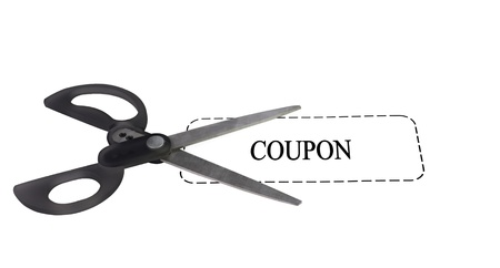 pair of scissors on top of a white generic coupon Stock Photo - 9819104