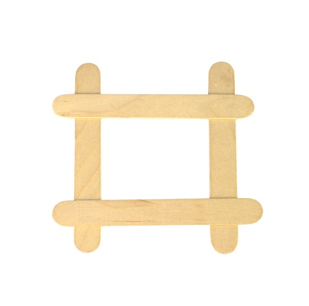 popsicle sticks arranged in a frame formation isolated on a white background Stock Photo
