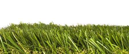 patch of manicured green artificial grass on a white background