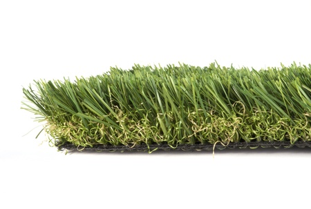 manicured: patch of green artificial grass on a white background