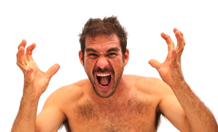 Man yelling with hands in air on a white background Foto de archivo