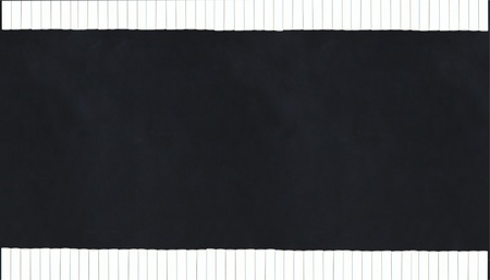 chalk sticks making a border along a black chalkboard - horizontal