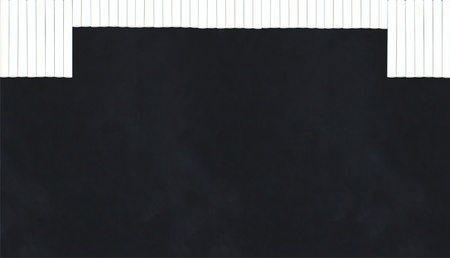 chalk sticks in a row creating a curtain on a blackboard Stock Photo