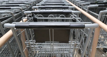 front view multiple rows of metal shopping carts outside a grocery store Stock Photo