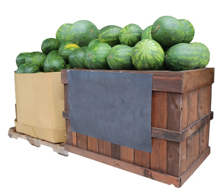 watermelons in crate and box on display for sale with blank chalkboard sign