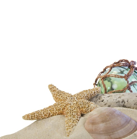 seashells on sand with glass ball on white background