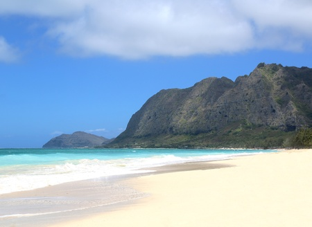 hawaii empty beach scene with mountains and sky photo