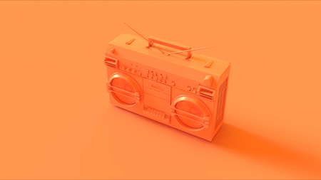 speakers: Orange boombox on a orange background