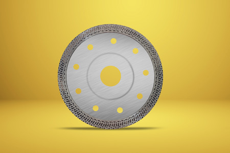 Cutting disk with diamonds - Diamond disc for concrete isolated on the yellow background