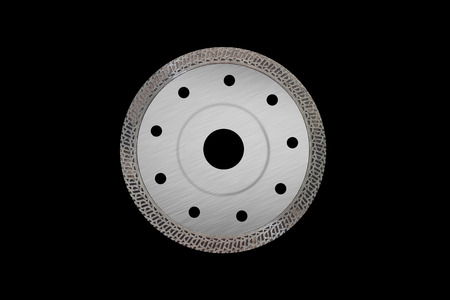 Cutting disk with diamonds - Diamond disc for concrete isolated on the black background