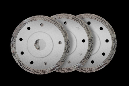 Cutting disks with diamonds - Diamond discs for concrete isolated on the black background
