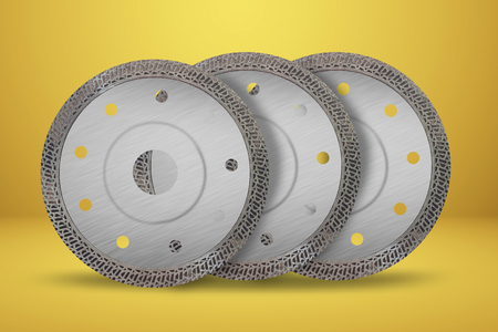 Cutting disks with diamonds - Diamond discs for concrete isolated on the yellow background Reklamní fotografie