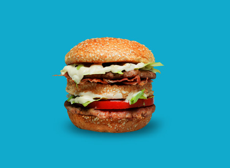 Big hamburger on blue background