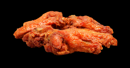 Grilled chicken wings isolated on black background . Reklamní fotografie
