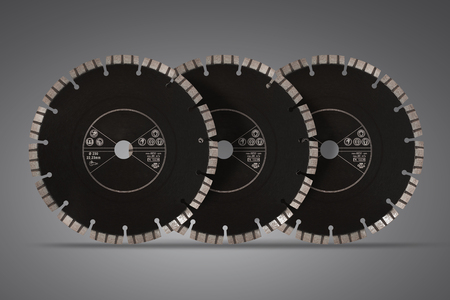 Cutting discs with diamonds - Diamond discs for concrete isolated on the gray background