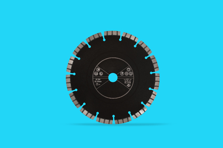 Cutting disc with diamonds - Diamond disc for concrete isolated on the blue background Reklamní fotografie