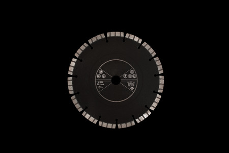 Cutting disc with diamonds - Diamond disc for concrete isolated on the black background Reklamní fotografie