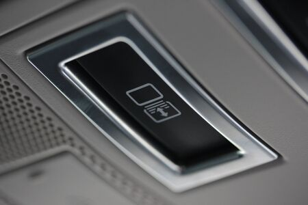 Vehicle sunroof button