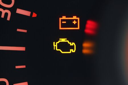 Vehicle engine and battery warning lights