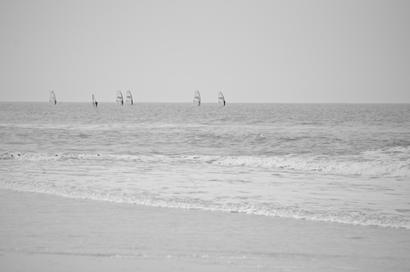 Windsurfers riding the waves Stock Photo