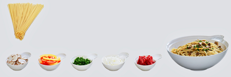 Pasta dish incl. All individual ingredients. Spaghetti, onion, paprika, ham, herbs. Italian food.