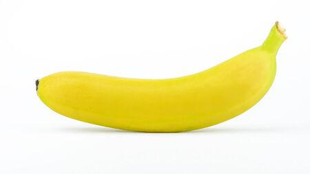 One ripe yellow banana isolated on a white background.