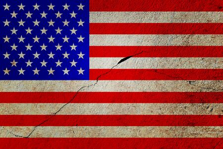 Flag of United States of America painted on old cracked wall with lighter center.