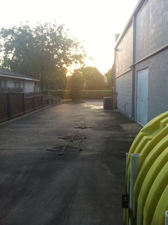 A suburban alley way as the sun rises