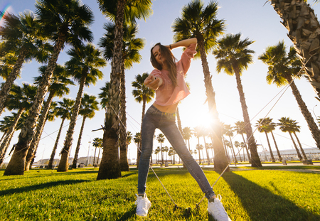 fashion young beautiful woman on a background of palm trees