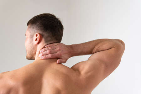The muscles of the neck in a man on a white background are hurt back painful, person massage adult, hand therapy, lower suffer attractive Stock Photo