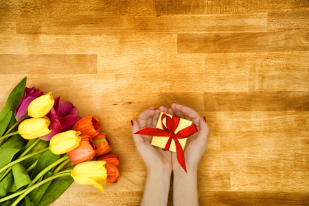 short phrase: Gift and flowers for Mothers day Stock Photo