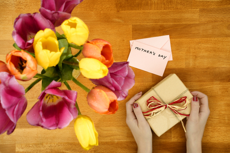 short phrase: Gift and tulip for Mothers Day