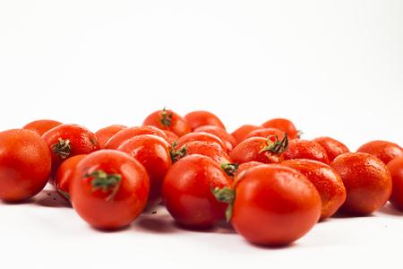 Fresh red tomatos on white isolated background cherry tomato