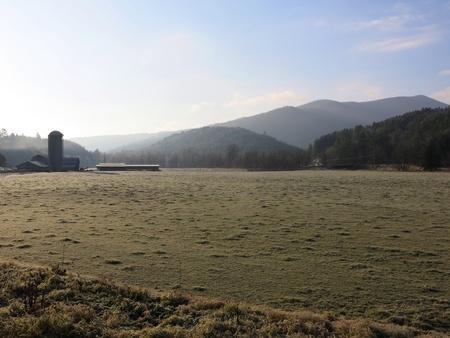 Farmland with silo and mountains Banco de Imagens