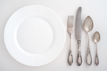 Vintage cutlery set with fork, knife, spoon and plate photo