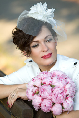 Portrait of an extravagant bride with a bouquet of flowers