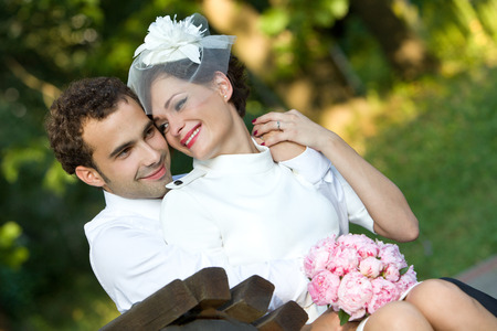 Wedding theme  Bride and groom with a bouquet of flowers  Happy couple  photo