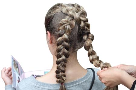Hairdresser making a braid for a girl  Children s hairstyle  Braids  Zdjęcie Seryjne