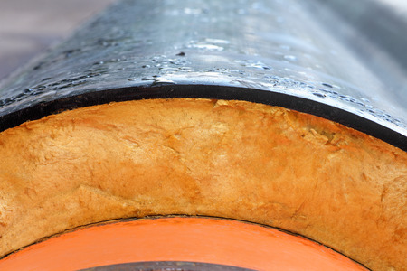 Insulation  Steel Pipe with Heat Insulation closeup  photo