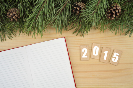 New Year background. Notebook on table with Christmas fir tree and wooden tablets with text \\\2015\\\ photo