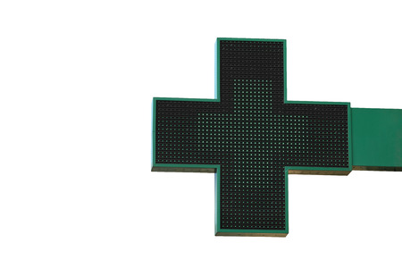 cross street with care: Pharmacy sign isolated. Green pharmacy cross with LED backlight.