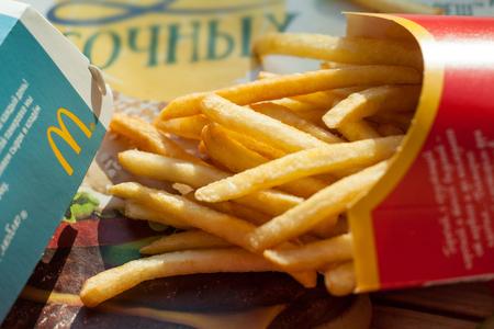 Minsk, Belarus, june 6, 2017: burger and french fries in a McDonalds restaurant.