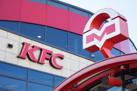 Minsk, Belarus, july 10, 2017: KFC fast food restaurant next to entrance to subway. Logos of KFS and Metro of Minsk