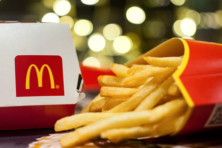 Minsk, Belarus, January 3, 2018: Big Mac Box with McDonalds logo and French fries in McDonalds Restaurant
