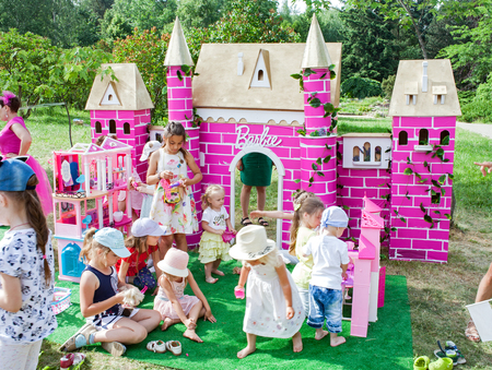 Minsk, Belarus, June 3, 2018: Children play with dolls on the playground Barbie Publikacyjne