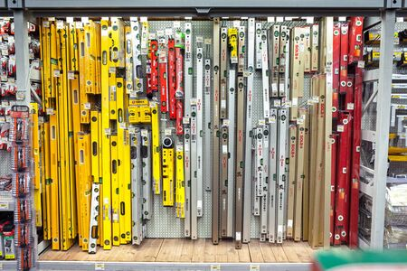 Measuring tape leveling of different brands for sale in shop for construction and repair