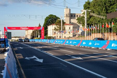 Minsk, Belarus, June 22, 2019: Finish of the distance of sports competitions and flags of the countries participating in the 2ND EUROPEAN GAMES  in the city of Minsk Redactioneel